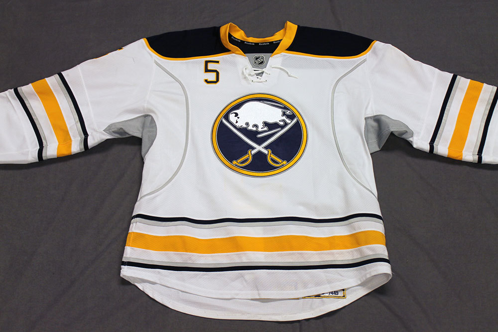 Chad Ruhwedel Game Worn Buffalo Sabres Away Jersey.  Serial: . Set 2 - Size 54.  2013-14 season.