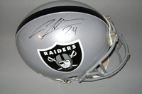 NFL - RAIDERS CHARLES WOODSON SIGNED RAIDERS PROLINE HELMET