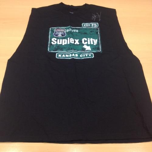 "Photo of Brock Lesnar SIGNED ""Suplex City: Kansas City"" T-Shirt"