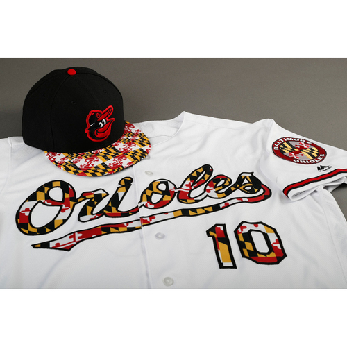 Photo of Adam Jones Autographed, Game-Worn Maryland Flag Jersey & Cap - Size 46