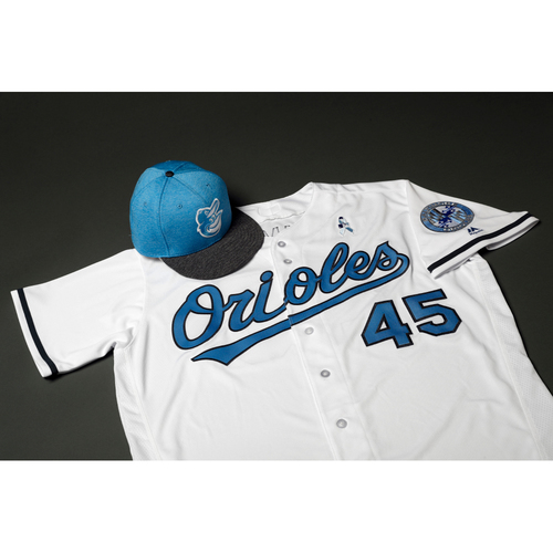 Photo of Adam Jones Autographed, Game-Worn Father's Day Jersey & Cap