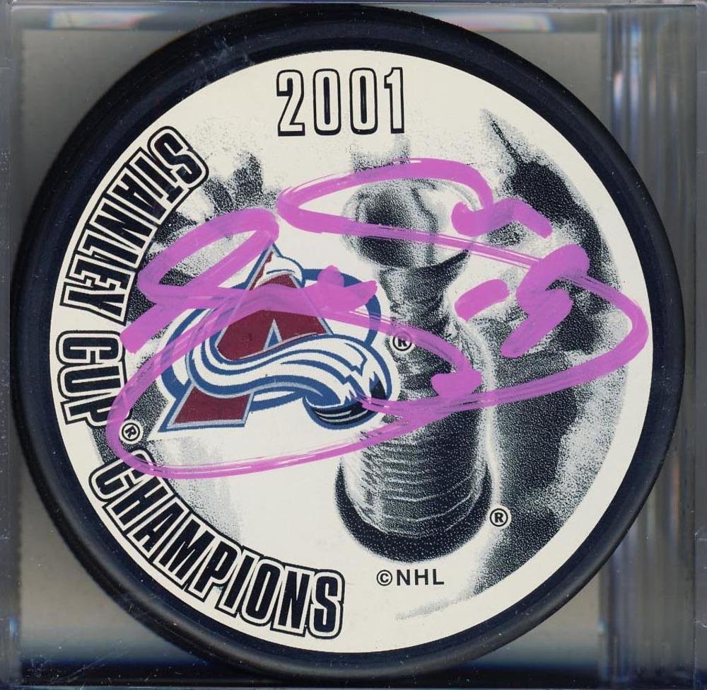 Joe Sakic Colorado Avalanche Autographed 2001 Stanley Cup Puck *Autograph Slightly Streaky*