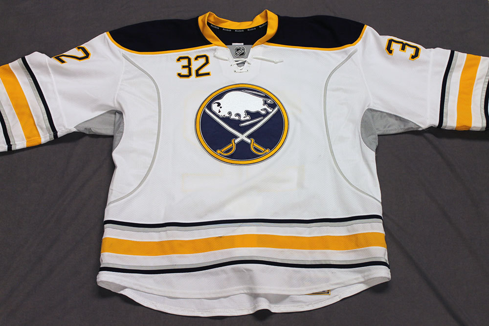 John Scott Game Worn Buffalo Sabres Away Jersey.  Serial: 1135-5. Set 2 - Size 58+.  2013-14 season.