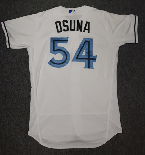 Photo of Authenticated Game Used Father's Day Jersey - #54 Roberto Osuna (June 18, 2017). Osuna went 1 IP with 0 hits, 0 ER, and 2 Ks
