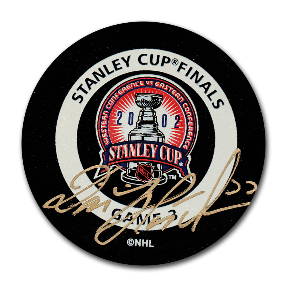 Dominik Hasek Autographed 2002 Stanley Cup Final Official Game 4 Puck (Detroit Red Wings)