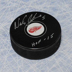 Nicklas Lidstrom Detroit Red Wings Autographed Hockey Puck with HOF Inscription