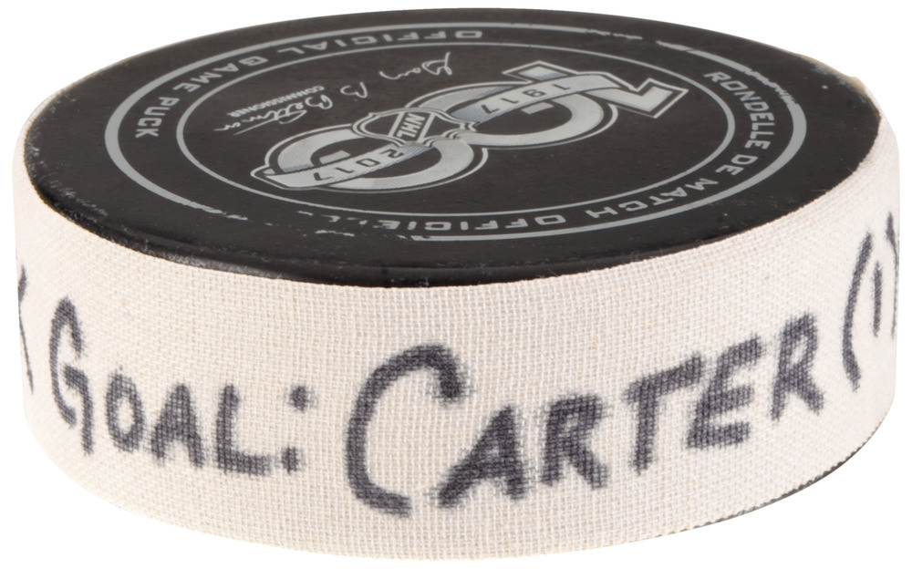 Jeff Carter Los Angeles Kings Game-Used Goal Puck from September 21, 2017 vs. Vancouver Canucks in Shanghai, China