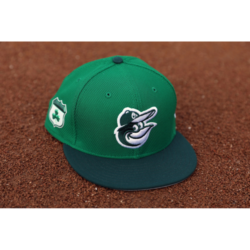 "Photo of Caleb Joseph Autographed, Team-Issued ""Go Green"" St. Patrick's Day Cap"