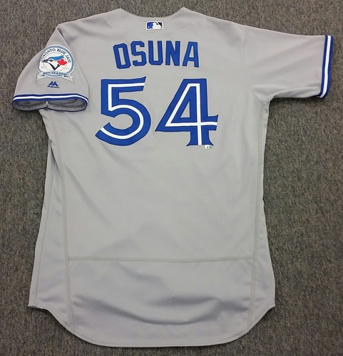 Photo of Authenticated Game Used #54 Roberto Osuna 2016 Opening Day Road Jersey - worn April 3, 2016 at Tampa Bay Rays. (1 IP, 1H, 2SO, 1SV)
