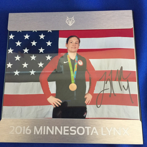 Photo of UMPS CARE AUCTION: Lindsay Whalen Signed Olympic Gold Medal Photo in Lynx Frame