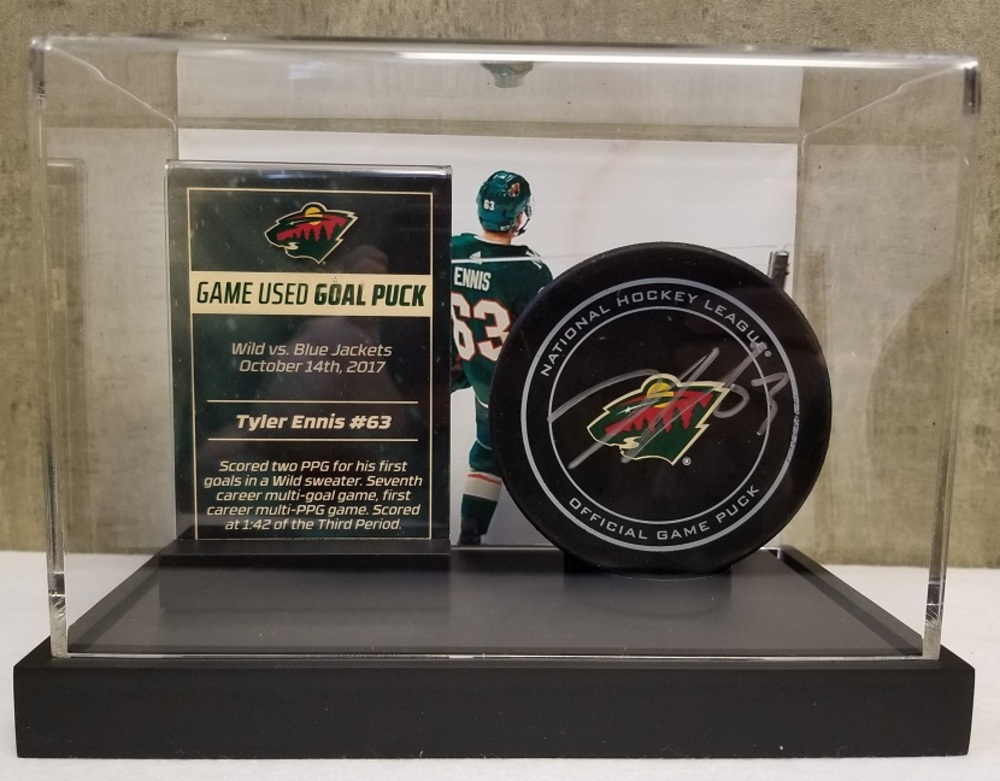 Wild Game Used Goal Puck- Ennis First Goal in Wild Sweater