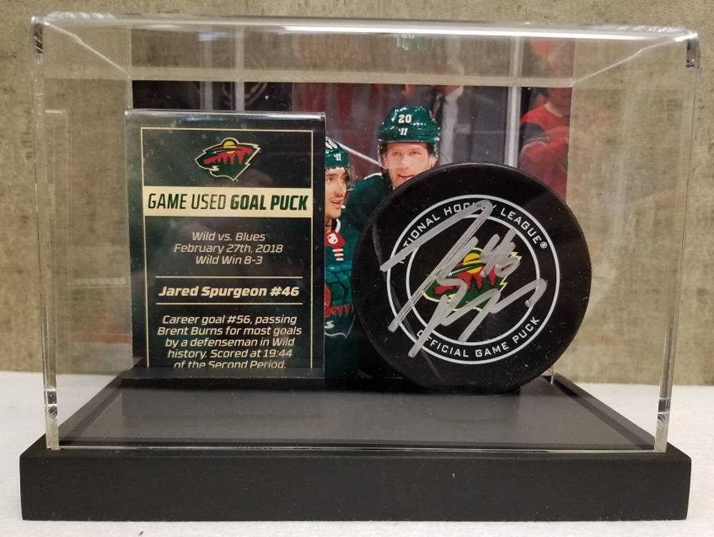 Wild Game Used Goal Puck-Spurgeon Career Goal #56, passes Burns for most goals by Wild defenseman