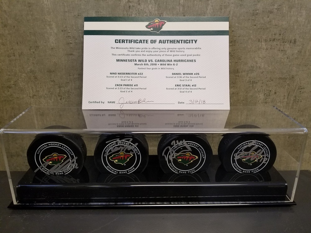 Wild Game Used Goal Puck-Fastest 4 Goals in Wild History