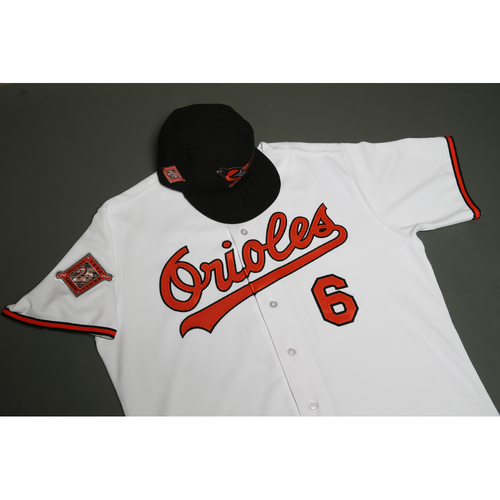 Photo of Adam Jones Autographed, Game-Worn 25th Anniversary Jersey & Cap