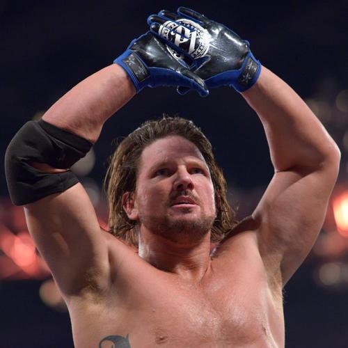 Photo of AJ Styles WORN & SIGNED Gloves (WWE Fastlane - 02/21/16)