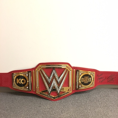 Photo of Kevin Owens SIGNED WWE Universal Championship Replica Title