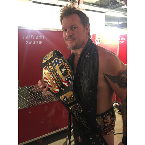 Photo of Chris Jericho SIGNED WWE United States Championship Replica Title (Payback - 04/30/17)
