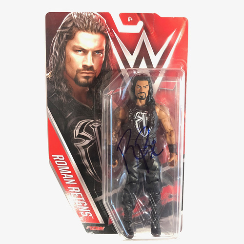Photo of Roman Reigns SIGNED Elite Series 33 Figure