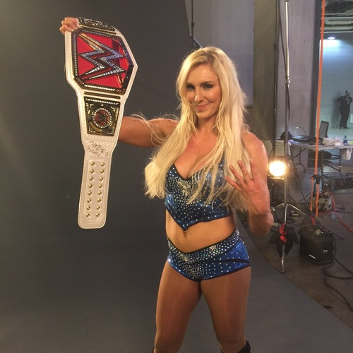 Photo of Charlotte SIGNED WWE Women's Championship Replica Title (WrestleMania - 04/03/16)