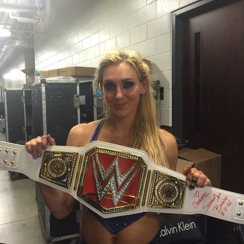 Photo of Charlotte SIGNED WWE Women's Championship Replica Title (SummerSlam - 08/21/16)