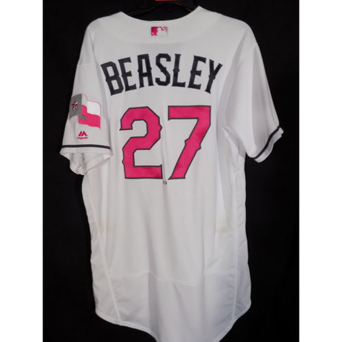 Photo of Game Worn Commemorative Mother's Day Jersey and Cap Worn By 3rd Base Coach Tony Beasley