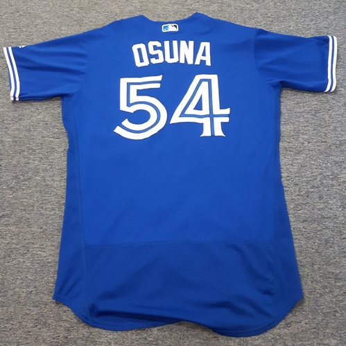 Photo of Authenticated Game Used Jersey - #54 Roberto Osuna. July 29, 2017 - 1 IP with 2 hits, 3 ER, 1 Walk and 1 K. Losing Pitcher. Size 44.