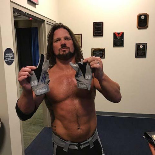 Photo of AJ Styles WORN & SIGNED Gloves