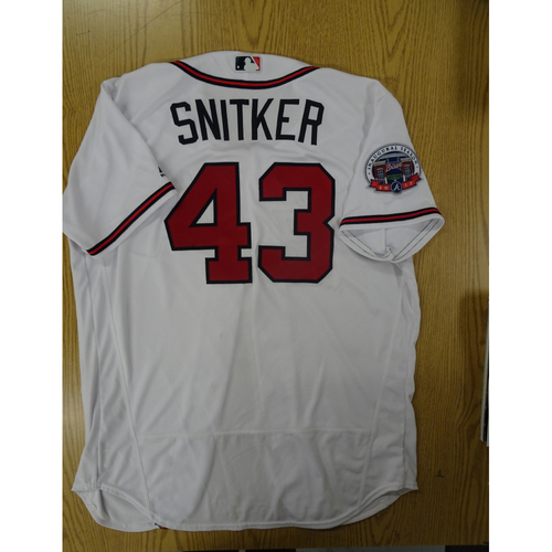 Photo of Brian Snitker Game-Used Los Bravos Jersey - Worn 9/17/17 at SunTrust Park