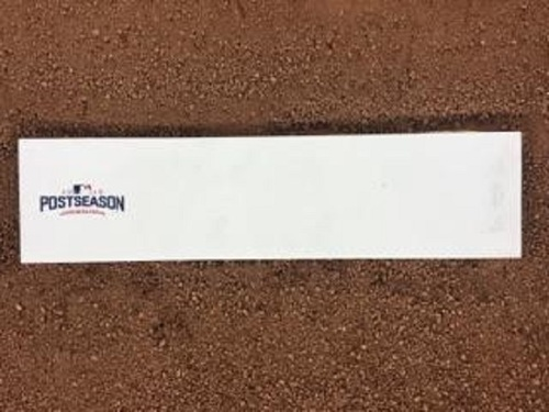 Photo of Authenticated Game Used Pitching Rubber from 2016 ALCS Game 4 Ceremonial First Pitch by Juan Guzeman - Oct 18, 2016