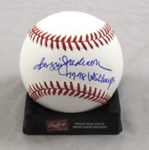 Photo of Reggie Jackson Autographed Official Major League Baseball with 77-78 WS Champs Inscription