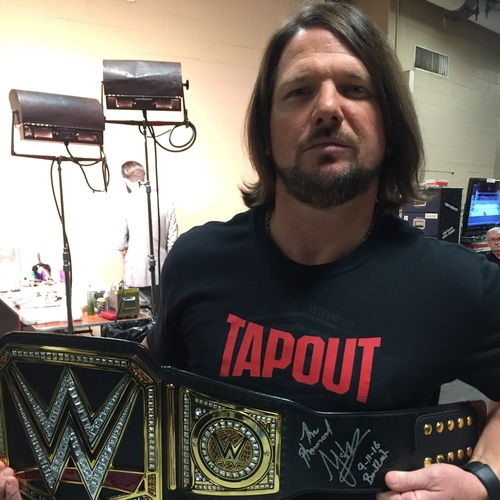Photo of AJ Styles SIGNED WWE World Championship Replica Title (BackLash - 09/11/16)