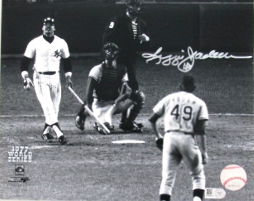 Photo of Reggie Jackson Autographed 8x10 Photograph (77 WS Home Run Swing)