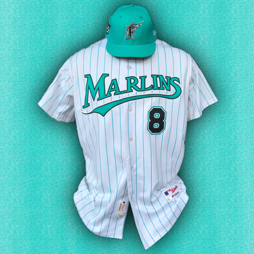 Photo of Marlins 25th Anniversary Game-Used Jersey & Cap:  Don Mattingly - Size: 46 & 7 3/8