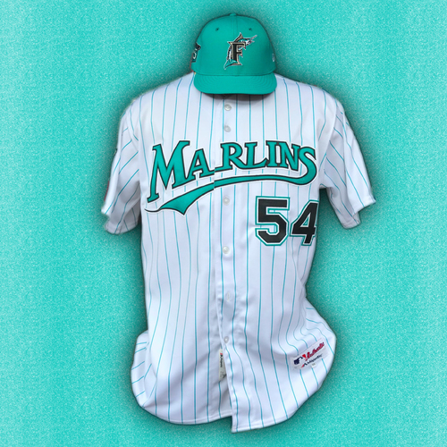 Photo of Marlins 25th Anniversary Game-Used Jersey & Cap:  Wei-Yin Chen - Size: 46 & 6 7/8