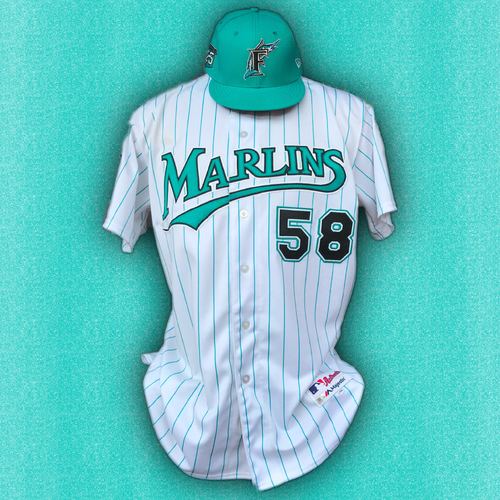 Photo of Marlins 25th Anniversary Game-Used Jersey & Cap:  Dan Straily - Size: 48 & 7 3/8