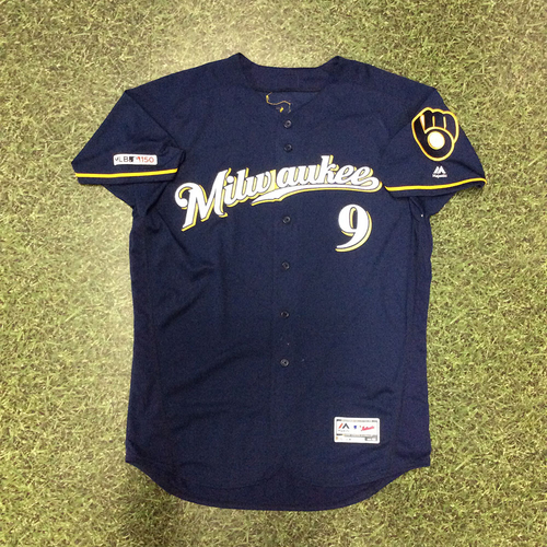 Photo of Manny Pina 2019 Game-Used Navy Ball & Glove Jersey