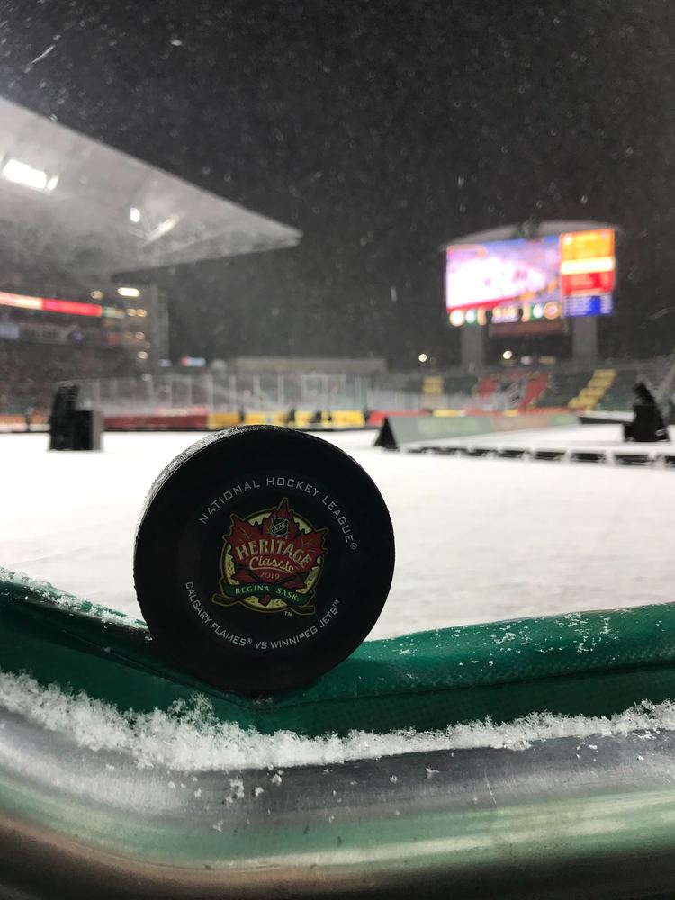 Calgary Flames vs. Winnipeg Jets 2019 NHL Heritage Classic Game-Used Puck - First Puck Collected