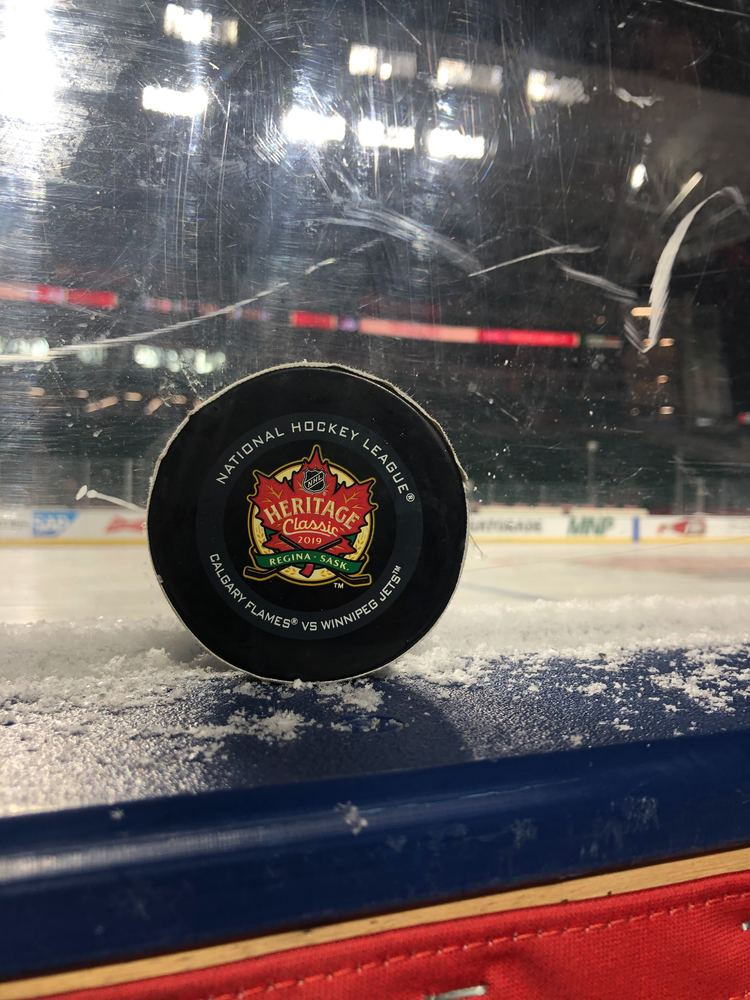 Josh Morrissey Winnipeg Jets Game-Used Goal Puck from the 2019 NHL Heritage Classic on October 26, 2019 vs. Calgary Flames