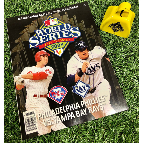 Photo of 2008 World Series Package: Official World Series Program and Cowbell - Tampa Bay Rays v Philadelphia Phillies
