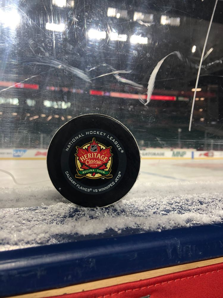 Calgary Flames vs. Winnipeg Jets 2019 NHL Heritage Classic Game-Used Puck - Used During Second Period