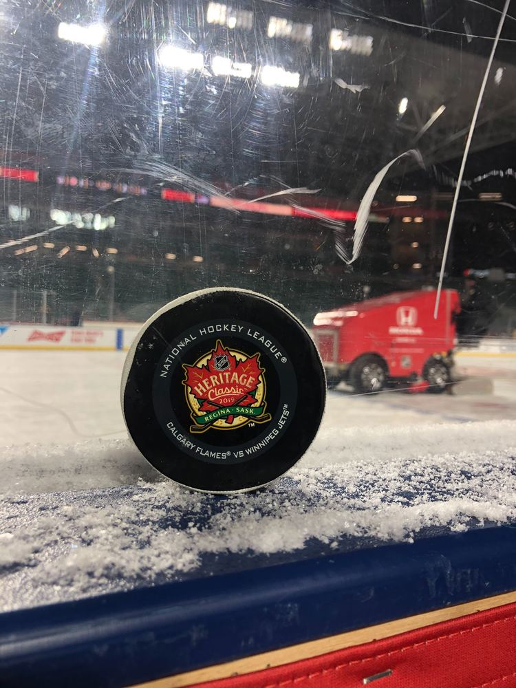 Calgary Flames vs. Winnipeg Jets 2019 NHL Heritage Classic Game-Used Puck - Used During Third Period
