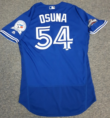 Photo of Authenticated Game Used Jersey - #54 Roberto Osuna (AL Wild Card Game and ALDS Game 3: Oct 4, 2016 and Oct 9, 2016). Osuna went 1.1 IP with 0 ER, and 2 Ks in the Wild Card Game and 2 IP with 0 ER and 2 Ks in ALDS Game 3. Winning Pitcher. Size 44