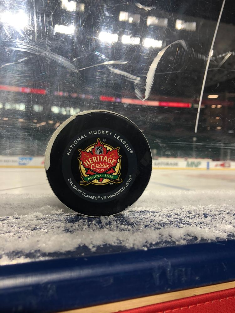 Calgary Flames vs. Winnipeg Jets 2019 NHL Heritage Classic Game-Used Puck - Used During Overtime