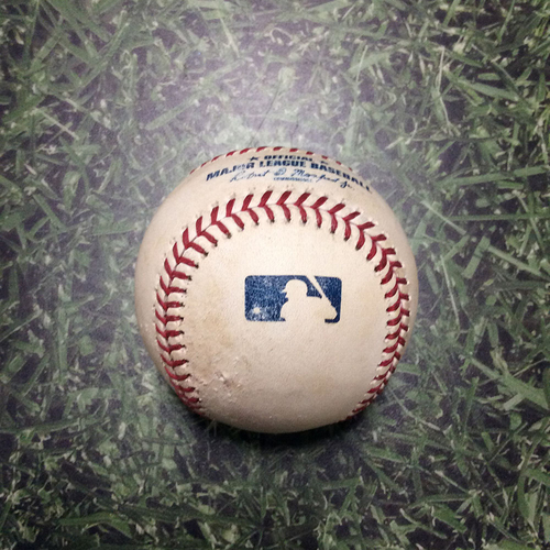 Photo of Game-Used Baseball PIT@MIL 08/24/18 - Joe Musgrove - Lorenzo Cain: Ground-Rule Double