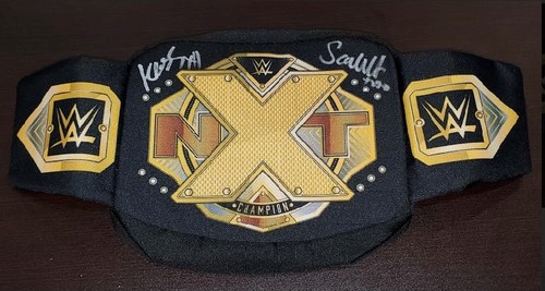 Photo of Karrion Kross and Scarlett SIGNED NXT Championship Title Waist Pack