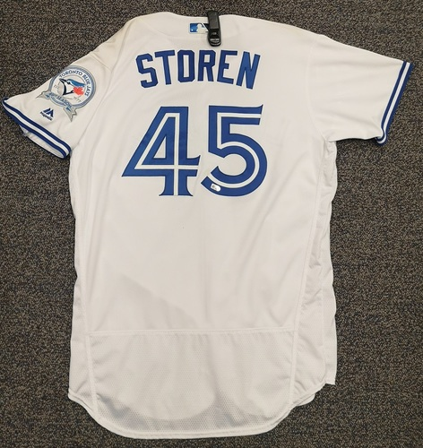 Photo of Authenticated Game Used Jersey - #45 Drew Storen (Apr 8, 16: Home Opener). 0.1 IP, 2 Hits, 2 ER. Size 46.