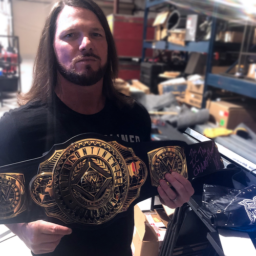 Photo of AJ Styles SIGNED WWE Intercontinental Championship Replica Title