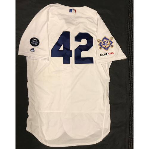 Photo of 2019 Game Used Home #42 Jersey worn by #12 Third Base Coach Dino Ebel on 4/15 Jackie Robinson Day against Cin. Dodgers 4-3 victory against Cincinnati. Size-44