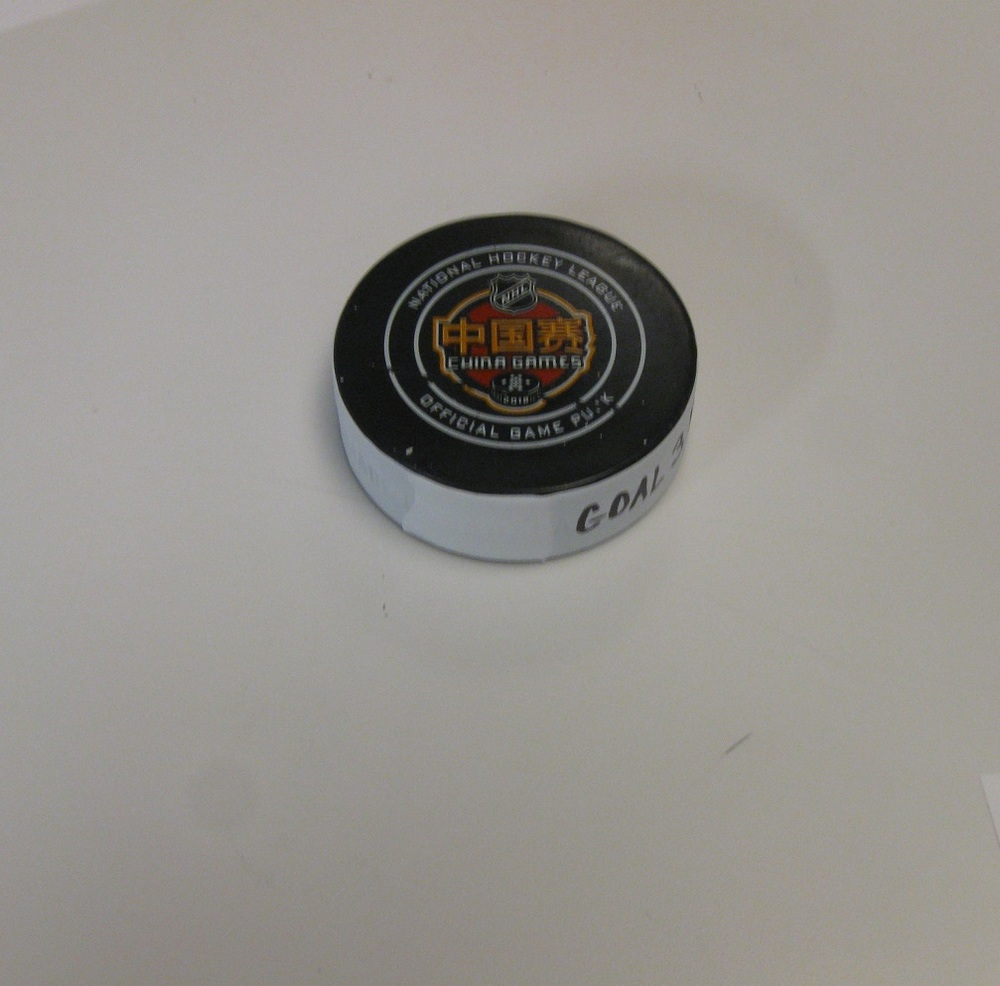 John Moore Boston Bruins Game-Used Goal Puck From