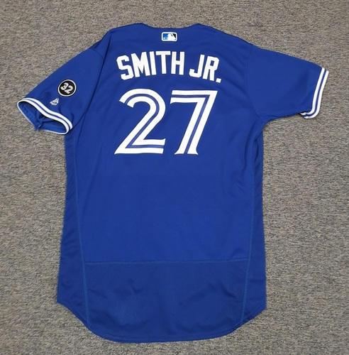 Photo of Authenticated Game Used Jersey - #27 Dwight Smith Jr. (July 13, 18: 1-for-3 with 1 HR, 1 Run and 3 RBIs). Size 46.